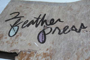 2 Featherpress Sign Close