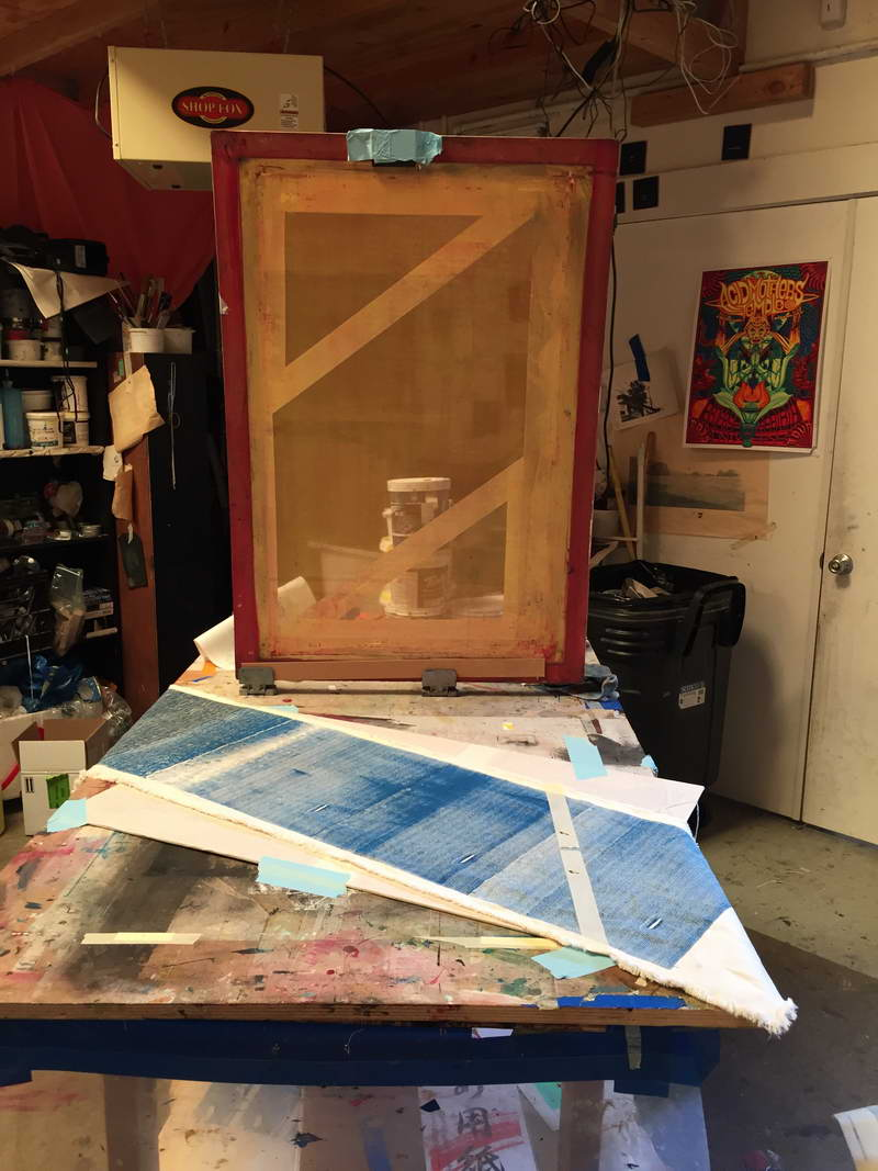 A jumbo 25 x 36 screen. There were 21 separate impressions of this screen to create this piece, all precisely roughly aligning to create the color gradient. Because of the angle of the gradient, the area is taped off in a parallelogram configuration.